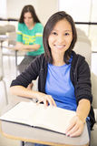 Confident student in the classroom. Portrait of smiling pretty student sitting at the in the  classroom Stock Photos