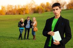 Confident student with friends Royalty Free Stock Photography