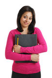 Confident student holding folder and pencil Royalty Free Stock Images