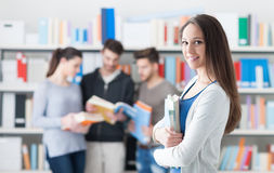 Confident student posing in the library Stock Photography