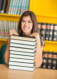 Confident Student Sitting With Stacked Books In Stock Images