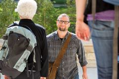 Confident Student Walking On College Campus. Portrait of confident male student walking on college campus Royalty Free Stock Photography