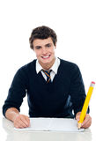 Confident student writing down notes. Isolated against white background Royalty Free Stock Image