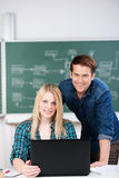 Confident Students With Laptop At Desk Royalty Free Stock Photography