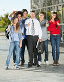 Confident Students And Professor Gesturing Royalty Free Stock Photos
