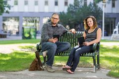 Confident Students Sitting On Bench At University Royalty Free Stock Photography