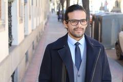 Confident stylish businessman walking outdoors.  stock photo