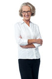 Confident stylish pose of smiling woman. Smiling aged woman posing with confidence Royalty Free Stock Photos