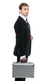 Confident stylish security guard whith a metal suitcase. Royalty Free Stock Photo