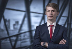 Confident stylish young man in a business suit Stock Images