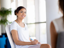 Confident and succcessful professional. Happy and confident young woman in an office Royalty Free Stock Photography