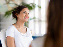 Confident and succcessful professional. Happy and confident young woman in an office Stock Images