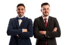 Confident and successful business men crossing arms against the Stock Images