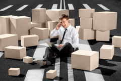 Confident and successful businessman sitting on the road and spe Stock Photos