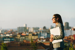 Confident and successful city business woman. Successful young businesswoman towards city background. Professional happy woman walking outside Stock Image
