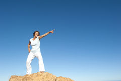 Confident and successful woman on mountain top Stock Photography