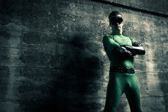 Confident superhero standing with arms crossed Stock Photography