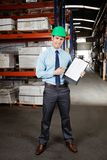 Confident Supervisor Displaying Clipboard Stock Image
