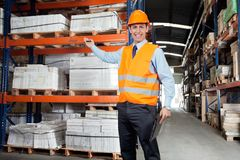 Confident Supervisor Showing Stock On Shelves Royalty Free Stock Images