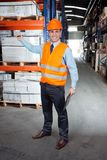 Confident Supervisor Showing Stock On Shelves Royalty Free Stock Photography