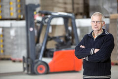 Confident Supervisor Standing At Warehouse Stock Photos