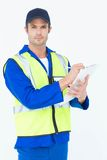 Confident supervisor writing notes on clipboard. Portrait of confident supervisor writing notes on clipboard over white background Stock Photo