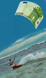Surfing man & Euro as kite, sail stock image