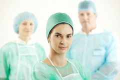 Confident surgeon with colleagues Stock Image