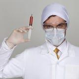 Confident surgeon holding a syringe Stock Photo