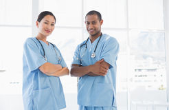 Confident surgeons with arms crossed in hospital Stock Photo