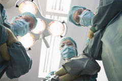 Confident Surgeons In Operating Theatre Royalty Free Stock Photography