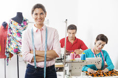 Confident Tailor With Arms Crossed Standing In Factory Stock Images