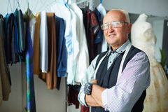 Confident tailor with crossed arms Royalty Free Stock Image