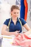 Confident tailor at work. Royalty Free Stock Photography