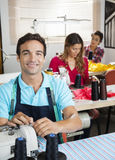 Confident Tailor Working In Sewing Factory Royalty Free Stock Photos