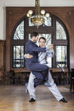 Confident Tango Dancer Lifting Male Partner royalty free stock image