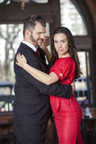 Confident Tango Dancer Performing With Male Partner. Portrait of confident tango dancer performing with male partner in restaurant Royalty Free Stock Image