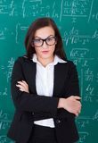 Confident teacher standing arms crossed Stock Images