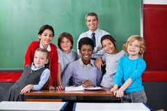 Confident Teachers With Schoolchildren Together At Stock Photo