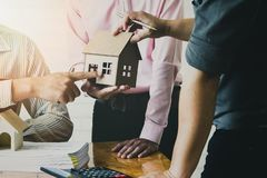 Confident team of architect working together in a office. royalty free stock images