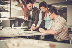 Confident team of engineers working together in a architect stud Royalty Free Stock Images