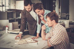Confident team of engineers working together in a architect stud Royalty Free Stock Photos