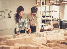 Confident team of engineers working together in a architect stud. Io royalty free stock photo