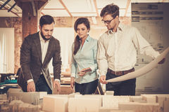 Confident team of engineers working together in a architect stud. Io Royalty Free Stock Images
