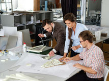Confident team of engineers working together in a architect stud. Io royalty free stock photography