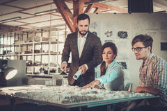 Confident team of engineers working together in a architect stud. Io stock photos
