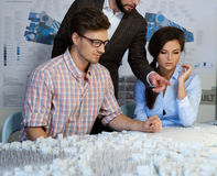 Confident team of engineers working together in a architect stud. Io royalty free stock image
