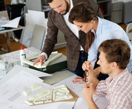 Confident team of engineers working together in a architect stud. Io royalty free stock photos