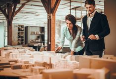 Confident team of engineers working together in a architect studio royalty free stock photography