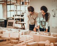 Confident team of engineers working together in a architect studio stock photography